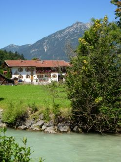 traditional Bavarian home by a river