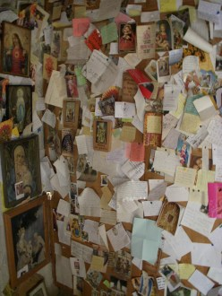Letters of thanks to Maria for prayers answered posted on the walls of Maria Eich Chapel in Planegg, Germany