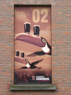 Mural of Guinness toucans outside the St. James Gate brewery, Dublin, Ireland