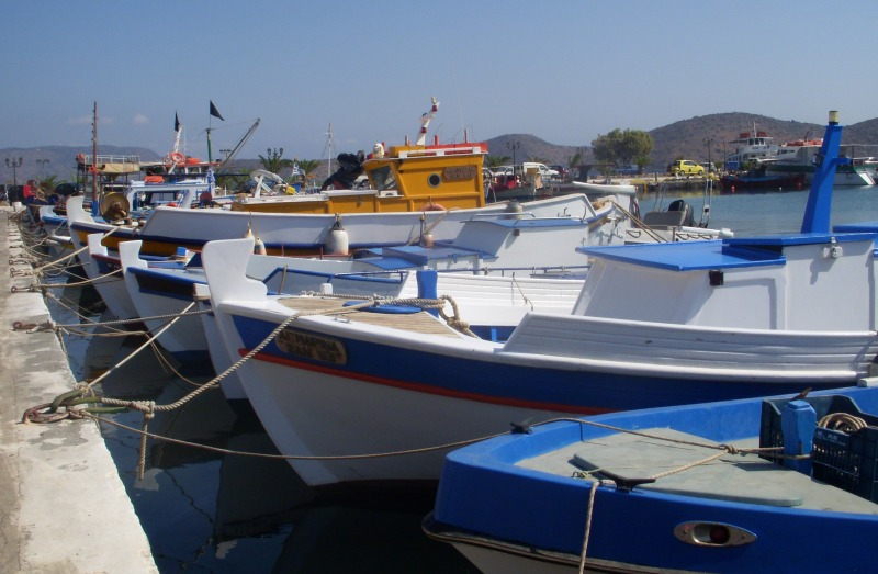 Blue boats in the harbor at Elounda, Crete, Greece