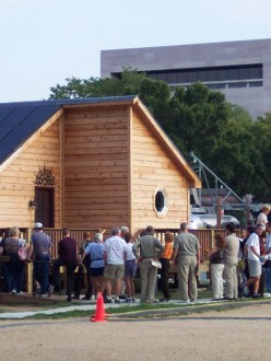 line of people waiting to enter a Solar Decathlon house on the National Mall in Washington, DC