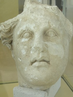 an ancient stone statue face
