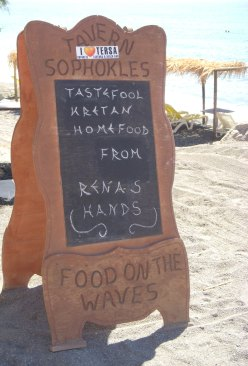 restauarant sign on a beach in Greece