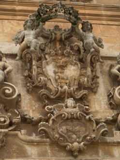 ornate angels carved in stone