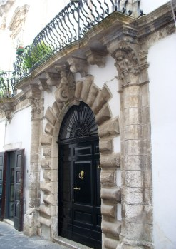 an ornate door in southern Italy