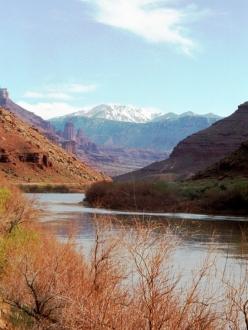 Utah scene with stream, cliffs, snowy mountain