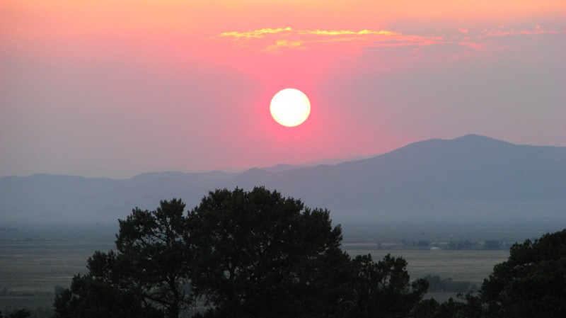 a sunset enhanced by smoke from wildfires