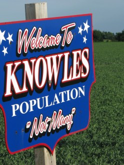 A sign that says: Welcome to Knowles, Wisconsin. Population: Not Many