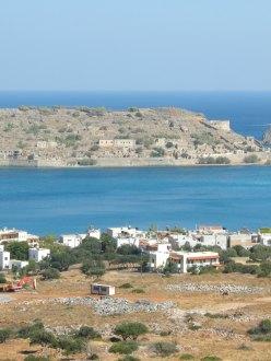vacation homes overlook the island of Spinalonga, Crete, Greece