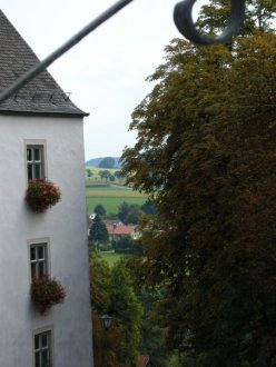 view of a white building in Bavaria with the countryside in the distance