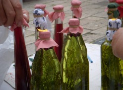 bottles of homemade grappa for sale in the market in Dubrovnik, Croatia