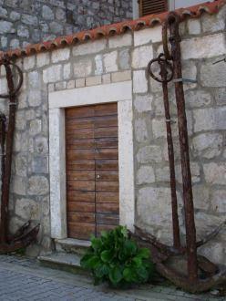ship anchors frame a doorway in Croatia