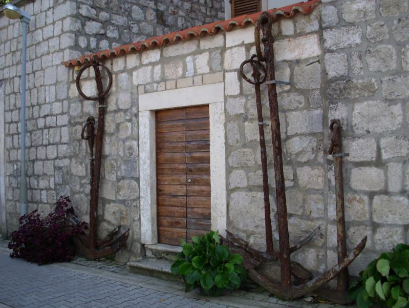 ship anchors frame a doorway in Croatia