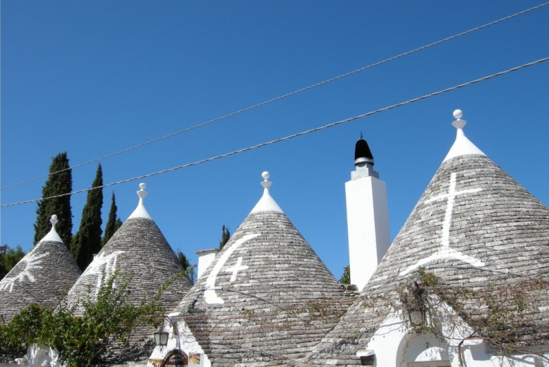 trulli house roof symbols in Alberobello, Italy