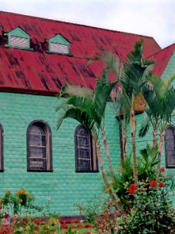turquoise green and red church in Costa Rica