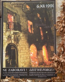 a poster in Dubrovnik, Croatia, advertising an exhibition of photos from the Balkan Conflict in 1991
