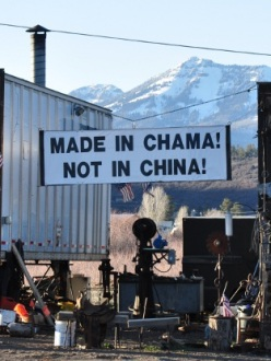 a store in Chama, New Mexico, with a sign out front that says: Made in Chama! Not in China!
