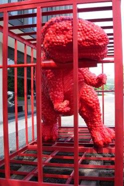 red T-Rex street art in Houston