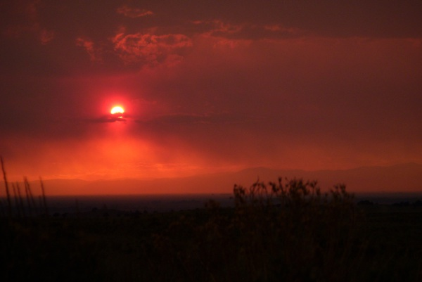 Multiple fires in Colorado and New Mexico create a smoky sunset in Colorado's San Luis Valley.