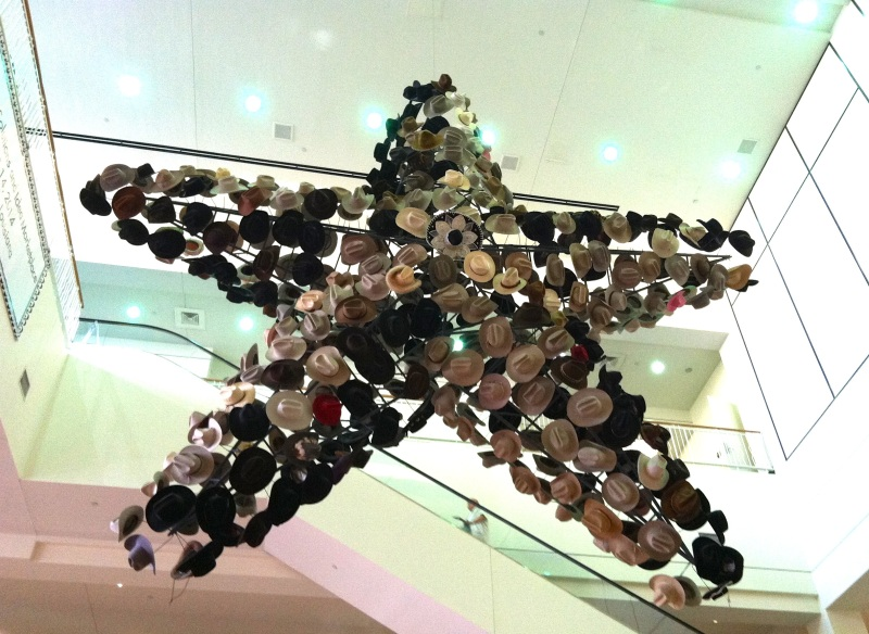 a gigantic star covered with hundreds of cowboy hats