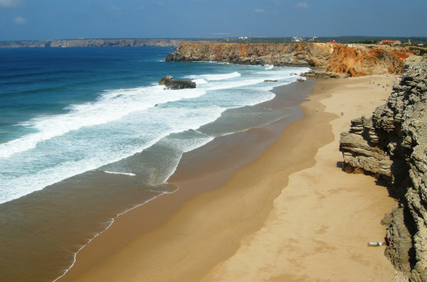 a sandy stretch of beach along the western coast of Portugal