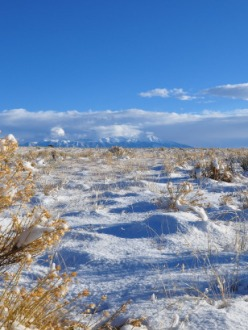 snowy San Luis Valley scene with mountains