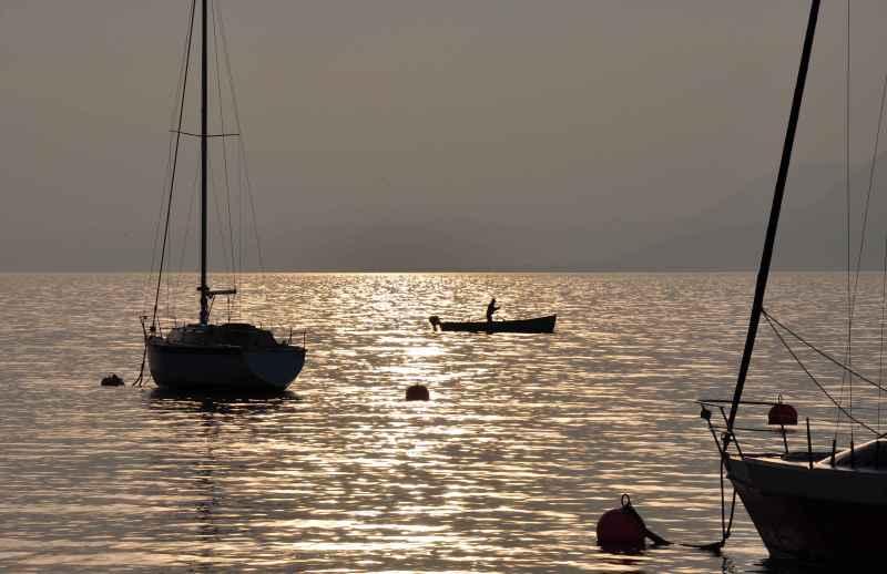 a man in a boat on Lago di Garda, Italy